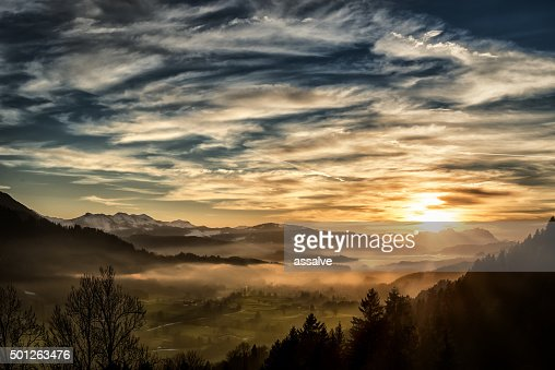 spectacular sunset over landscape at European alps in winter
