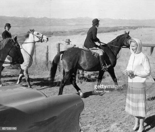 A spectator at the Thursday and Sunday Arapahoe hunts is Mrs Earl Morris who watches the riders as they take to the field at Highlands ranch the home...