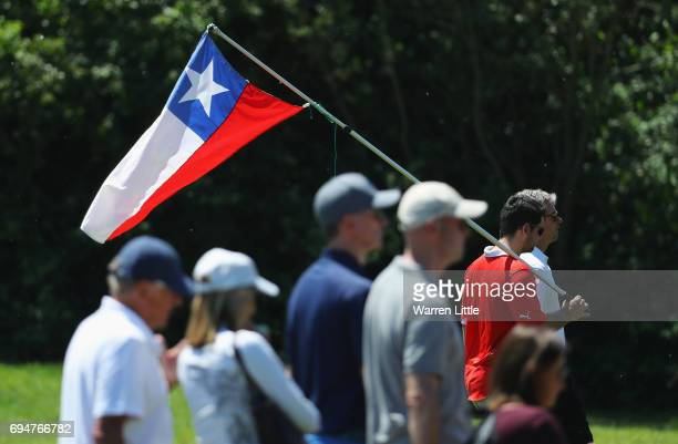 A spectator carries a Chile national flag during the final round on day four of the Lyoness Open at Diamond Country Club on June 11 2017 in...