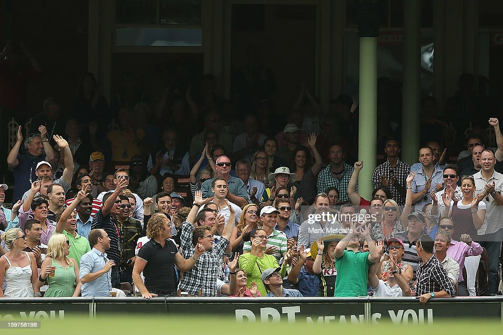 A spectator catches a ball during game four of the Commonwealth Bank one day international series between Australia and Sri Lanka at Sydney Cricket Ground on January 20, 2013 in Sydney, Australia.