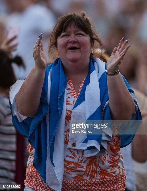 A spectator celebrates Andy Murray's victory over Fabio Fognini during their Gentlemen's Singles second round match from 'Murray Mound' on day five...
