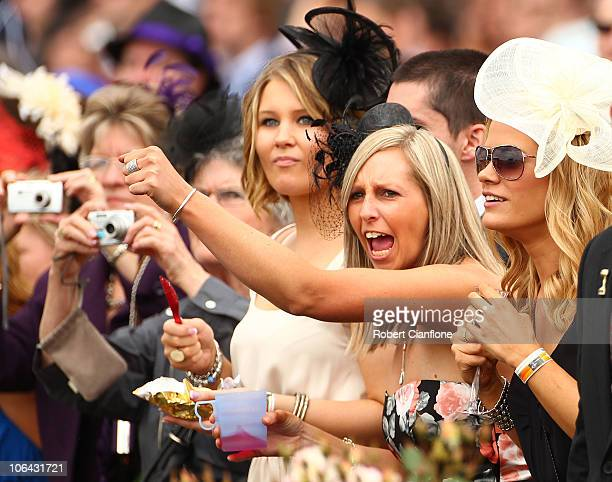 A spectator cheers during race four The Herald Sun Stakes during Melbourne Cup Day at Flemington Racecourse on November 2 2010 in Melbourne Australia