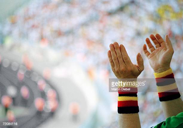Spectator clapping hands at sports event