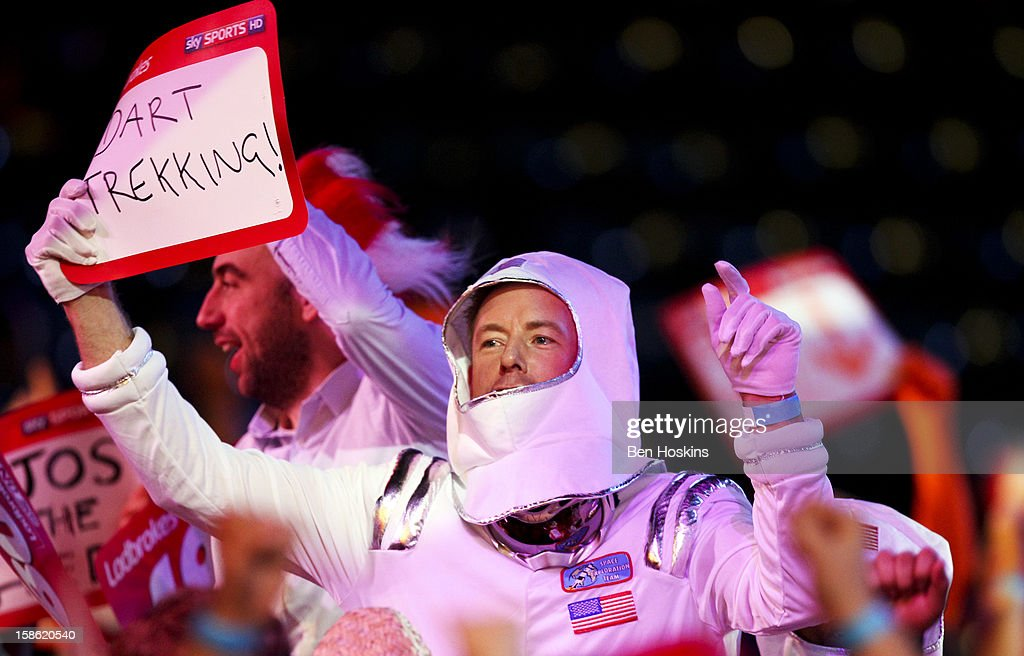 A spectator dressed as anb astronaut enjoys the atmosphere during day eight of the 2013 Ladbrokes.com World Darts Championship at the Alexandra Palace on December 21, 2012 in London, England.