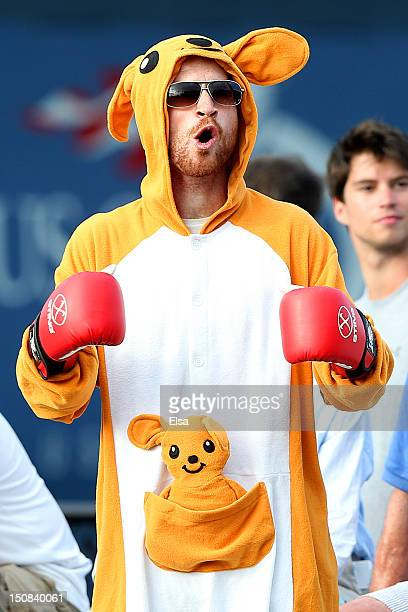 A spectator dressed in a kangaroo fancy dress costume cheers during the men's singles first round match between Tatsuma Ito of Japan and Matthew...