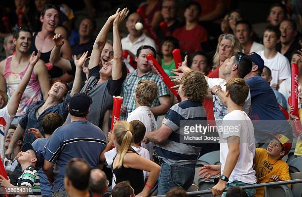 A spectator drops a catch during the Big Bash League match between the Melbourne Renegades and the Brisbane Heat at Etihad Stadium on December 22...