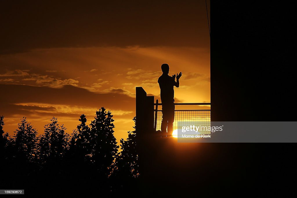 A spectator enjoys the atmosphere as the sun sets behind him during the round 16 A-League match between Adelaide United and the Perth Glory at Hindmarsh Stadium on January 11, 2013 in Adelaide, Australia.