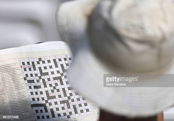 A spectator fills in a newspaper crossword during the LV County Championship match between Hampshire and Durham at Ageas Bowl on July 19 2015 in...