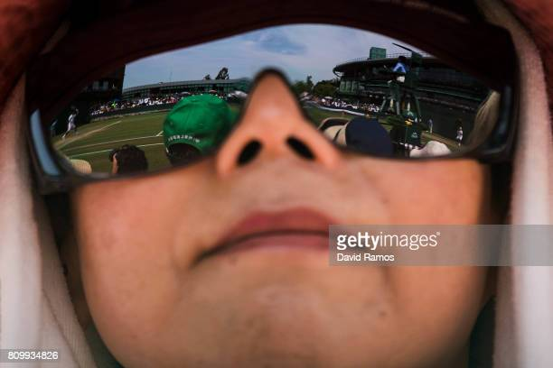 A spectator follow the action during the Gentlemen's Singles second round between Yuichi Sugita of Japan and Adrian Mannarino of France on day four...