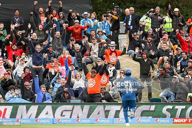 A spectator holds a one handed catch to win $1000000 during the 2015 ICC Cricket World Cup match between Sri Lanka and New Zealand at Hagley Oval on...