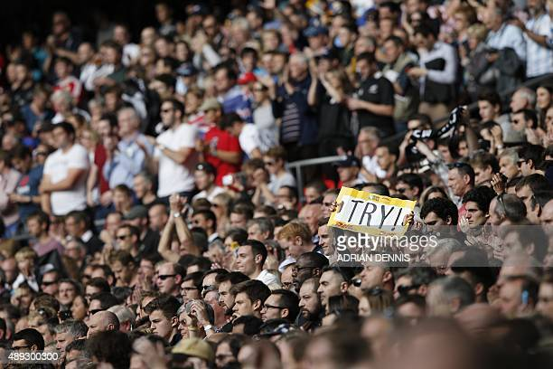 A spectator holds a placard during a Pool C match of the 2015 Rugby World Cup between New Zealand and Argentina at Wembley stadium north London on...