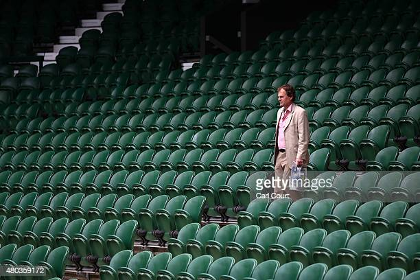 A spectator looks for his seat on Centre Court several hours ahead of the Ladies Singles Final between Serena Williams of the USA and Garbine...