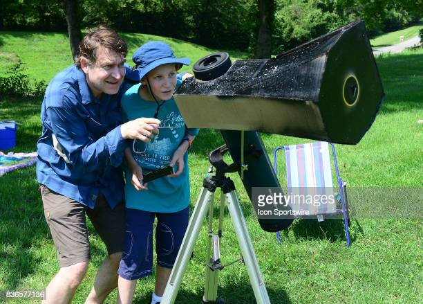 A spectator looks through a special telescope during a total eclipse of the sun on August 21 as viewed from the Cohen Recreation Center in Chester IL