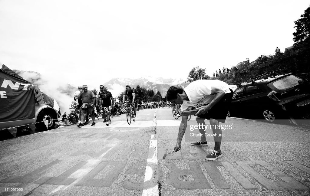 A spectator paints the road during stage eighteen of the 2013 Tour de France, a 172.5KM road stage from Gap to l'Alpe d'Huez, on July 18, 2013 in Alpe d'Huez, France.