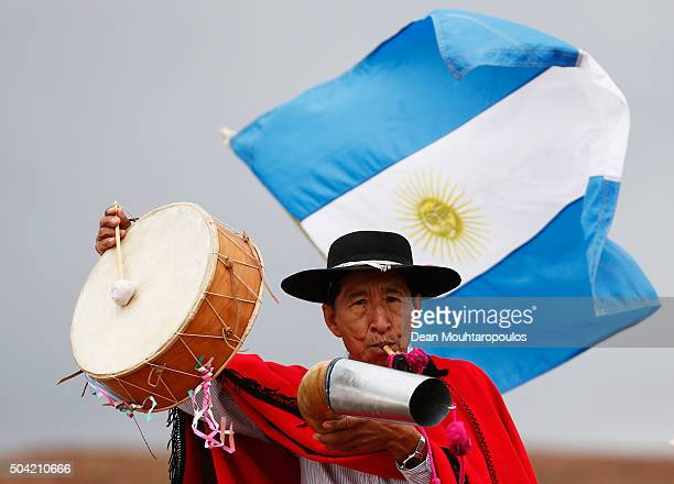 A spectator pictured with an Argentinian flag plays a Erke or horn and Caja or drum on day 7 stage seven from Uyuni in Bolivia to Salta in Argentina...