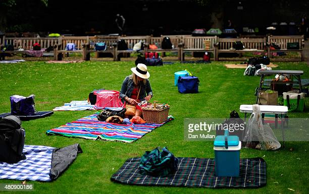 A spectator prepares her picnic in the Coronation Garden during day one of the 2nd Investec Ashes Test match between England and Australia at Lord's...
