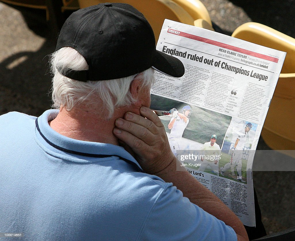 A spectator reads the latest sport headlines during the LV County Championship Division One match between Warwickshire and Lancashire at Edgbaston on May 20, 2010 in Birmingham, England.