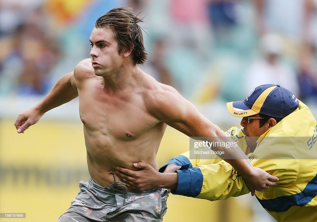 A spectator runs onto the field while during play during day two of the Second Test match between Australia and Sri Lanka at Melbourne Cricket Ground on December 27, 2012 in Melbourne, Australia.