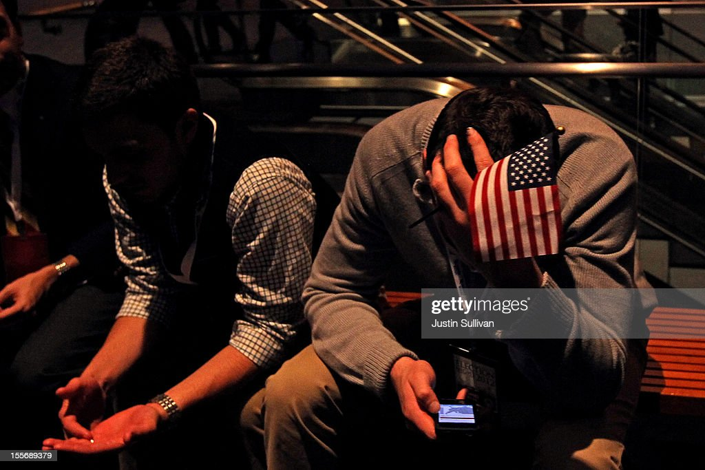 A spectator sits on a bench on his Apple iPhone while waiting for Republican presidential candidate, Mitt Romney, to concede his presidency during Mitt Romney's campaign election night event at the Boston Convention & Exhibition Center on November 7, 2012 in Boston, Massachusetts. After voters went to the polls in the heavily contested presidential race, networks projected incumbent U.S. President Barack Obama has won re-election against Republican candidate, former Massachusetts Gov. Mitt Romney.