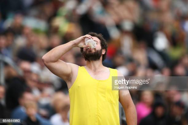 A spectator 'skulls' a beer during day three of the test match between New Zealand and South Africa at Basin Reserve on March 18 2017 in Wellington...
