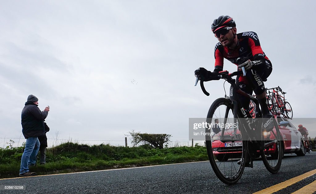 A spectator takes a picture as a rider competes in stage three of the Tour de Yorkshire cycle race rides by on May 1, 2016 in Whitby, England. Returning for a second year the hugely popular race has grown to be one of the most spectacular events in the British sporting calendar. Up to a million people have lined the route along the three stages of the race which ends today with the 198km Middlesbrough to Scarborough leg.