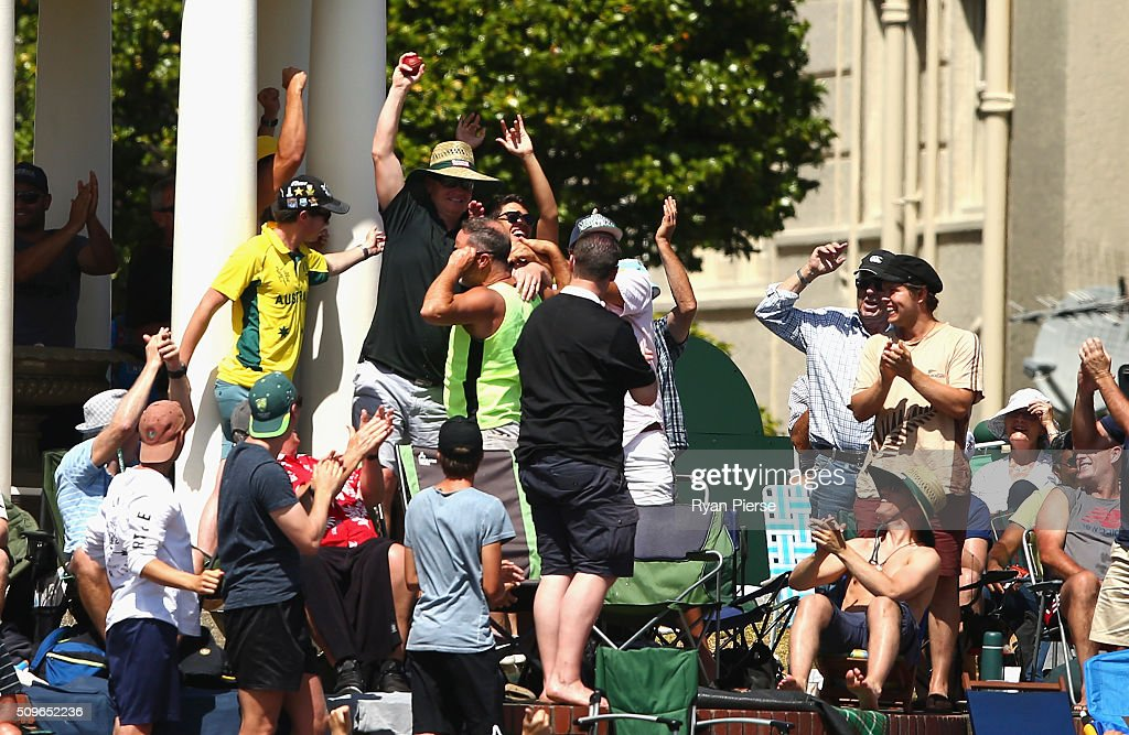 A spectator takes one of two catches in the same over during day one of the Test match between New Zealand and Australia at Basin Reserve on February 12, 2016 in Wellington, New Zealand.