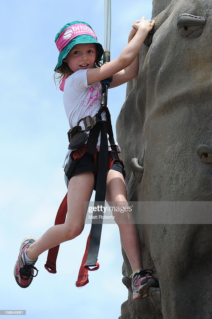 Spectator takes part rock climbing in the kids zone during day three of the Brisbane International at Pat Rafter Arena on January 1, 2013 in Brisbane, Australia.