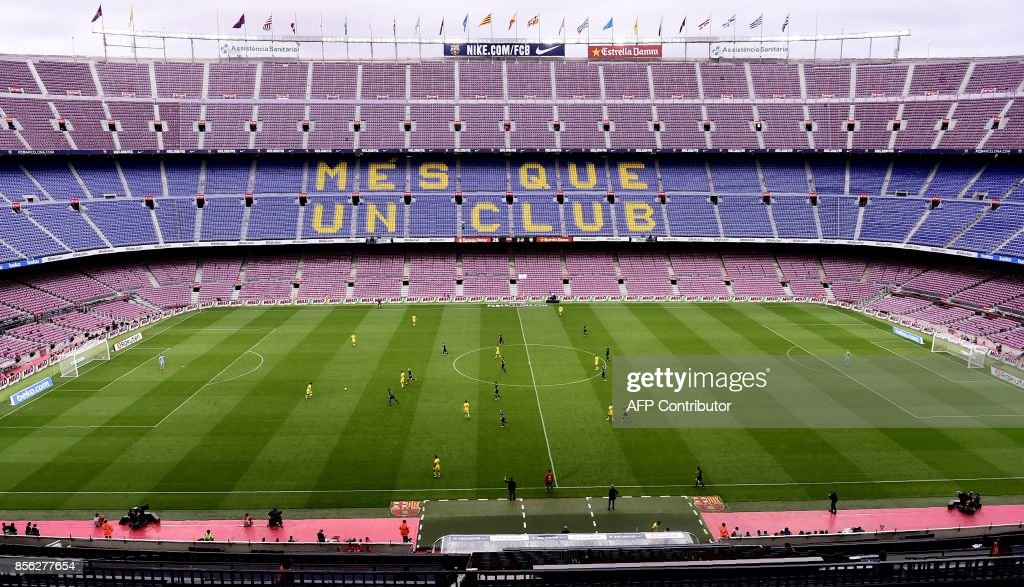 Spectator tribunes remain empty as the Spanish league football match FC Barcelona vs UD Las Palmas is played behind closed doors at the Camp Nou stadium in Barcelona on October 1, 2017. Barcelona's La Liga match against Las Palmas was played behind closed doors after the Spanish league refused to postpone the match. At least 91 people have been injured in clashes between police and activists in Catalonia over an independence referendum for the region deemed illegal by the Spanish government. /