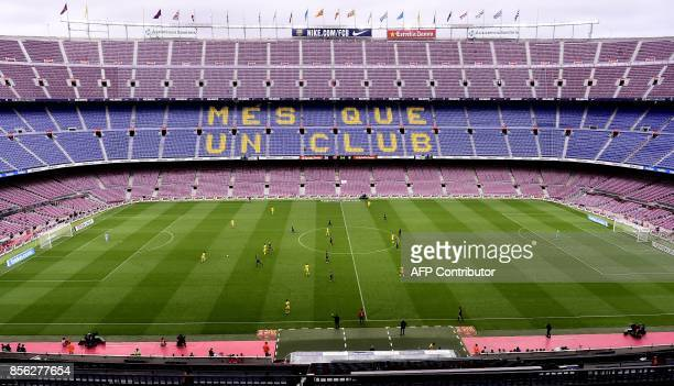 Spectator tribunes remain empty as the Spanish league football match FC Barcelona vs UD Las Palmas is played behind closed doors at the Camp Nou...