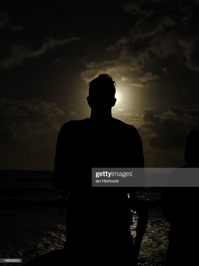 A spectator views the solar eclipse on November 14, 2012 in Palm Cove, Australia. Thousands of eclipse-watchers have gathered in part of North Queensland to enjoy the solar eclipse, the first in Australia in a decade.
