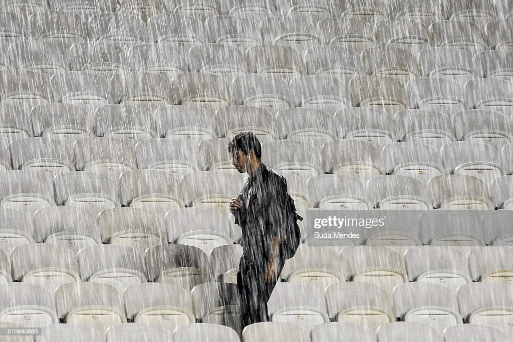 A spectator waits in the stands as rain suspends the match between David Ferrer of Spain and Albert Ramos-Vinolas of Spain during the Rio Open at Jockey Club Brasileiro on February 17, 2016 in Rio de Janeiro, Brazil.