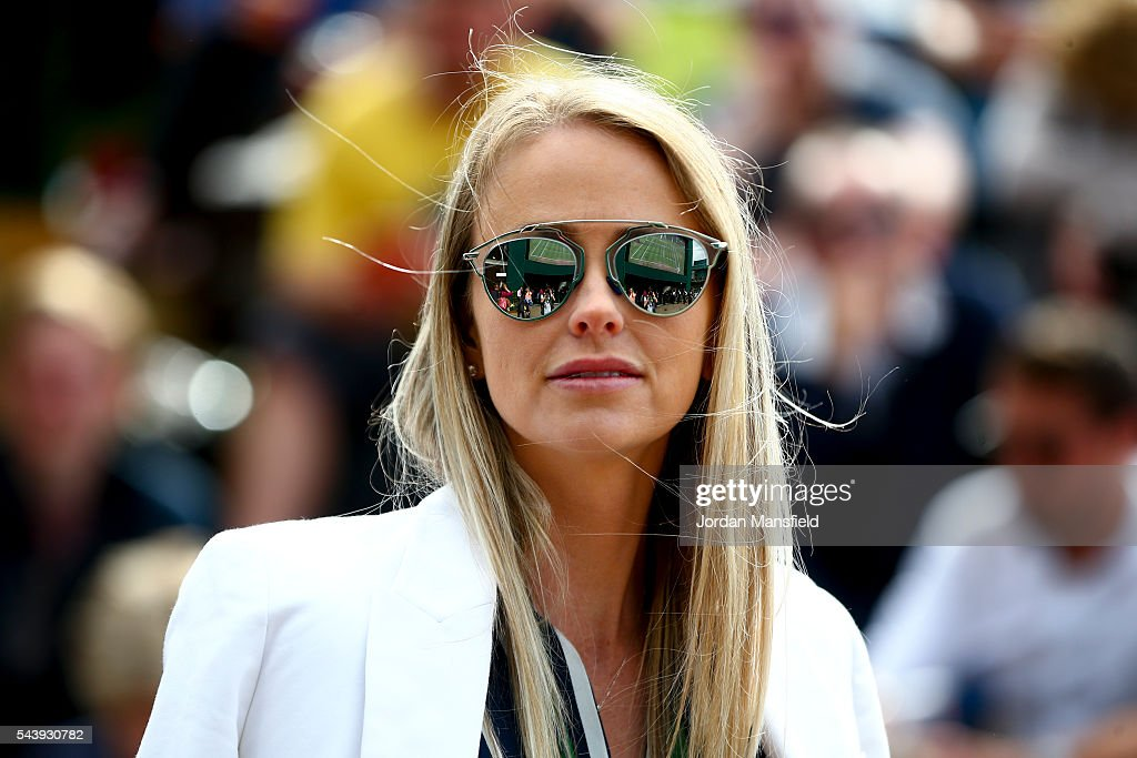 A spectator watches on during day four of the Wimbledon Lawn Tennis Championships at the All England Lawn Tennis and Croquet Club on June 30, 2016 in London, England.