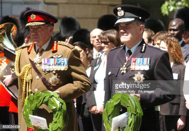 A spectator watches on from a window as from left General Sir Richard Dannatt Chief of General Staff and Sir Ronnie Flanagan Chief Inspector of...
