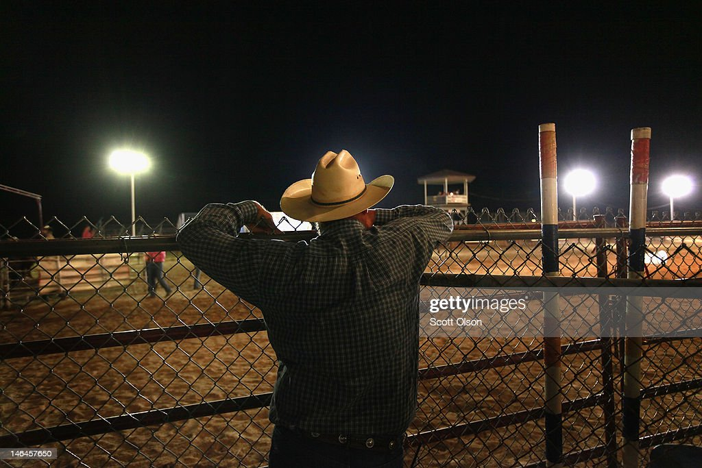 A spectator watches the events at the Illinois High School Rodeo Association State Finals on June 16, 2012 in Altamont, Illinois. Winners in the competition will go on to compete in the high school national championships July 15-21 in Rock Springs, Wyoming.