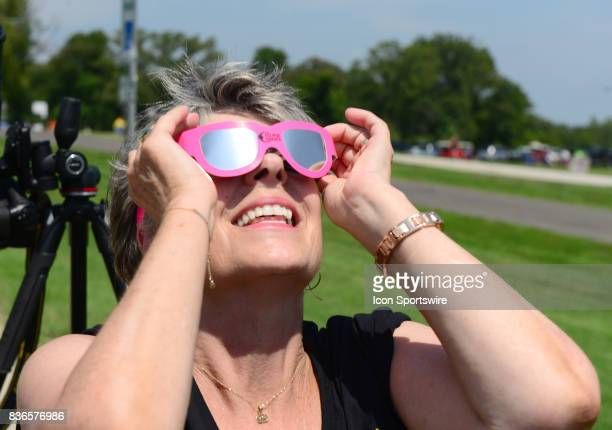 A spectator watches the progress of the eclipse during a total eclipse of the sun on August 21 as viewed from the Cohen Recreation Center in Chester...