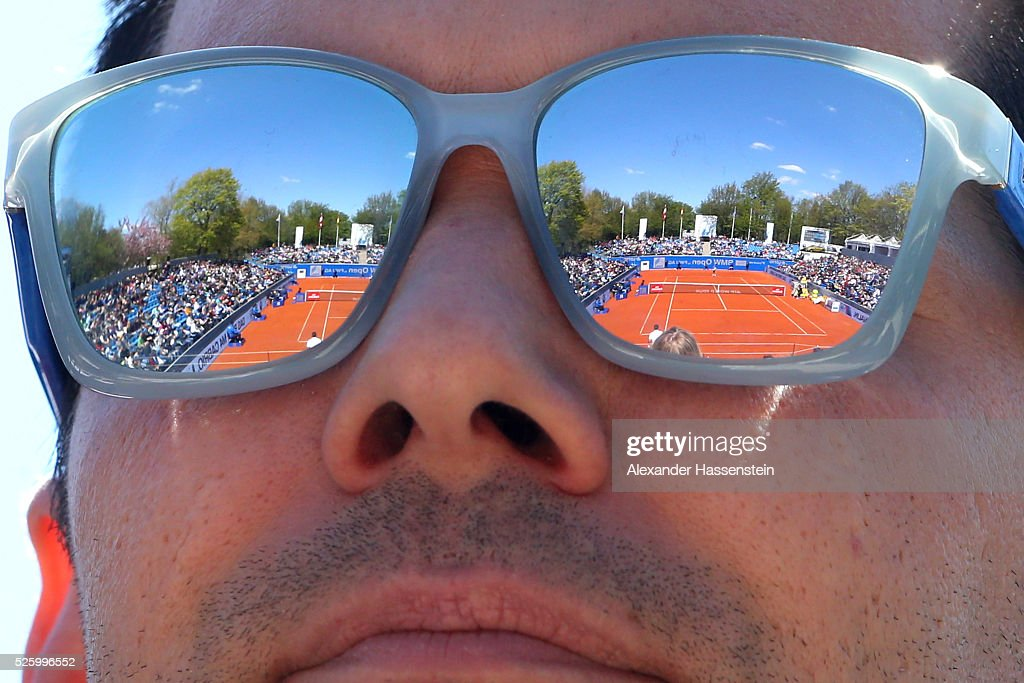 A spectator watches the quater final match between Dominic Thiem of Austria and Ivan Dodig of Croatia of the BMW Open at Iphitos tennis club on April 29, 2016 in Munich, Germany.