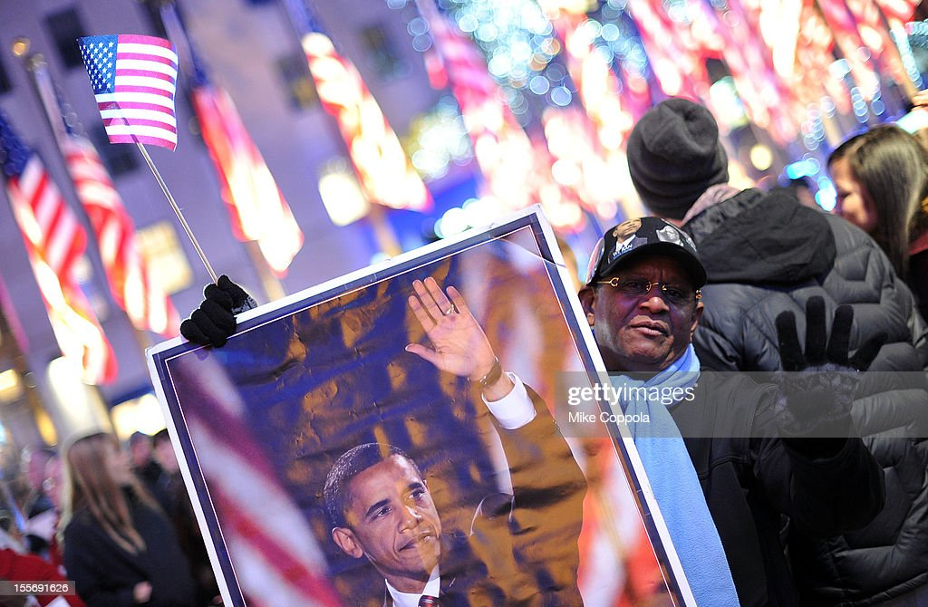 A spectator watches the results of the 2012 Presidential election night in Rockefeller Center on November 6, 2012 in New York City.