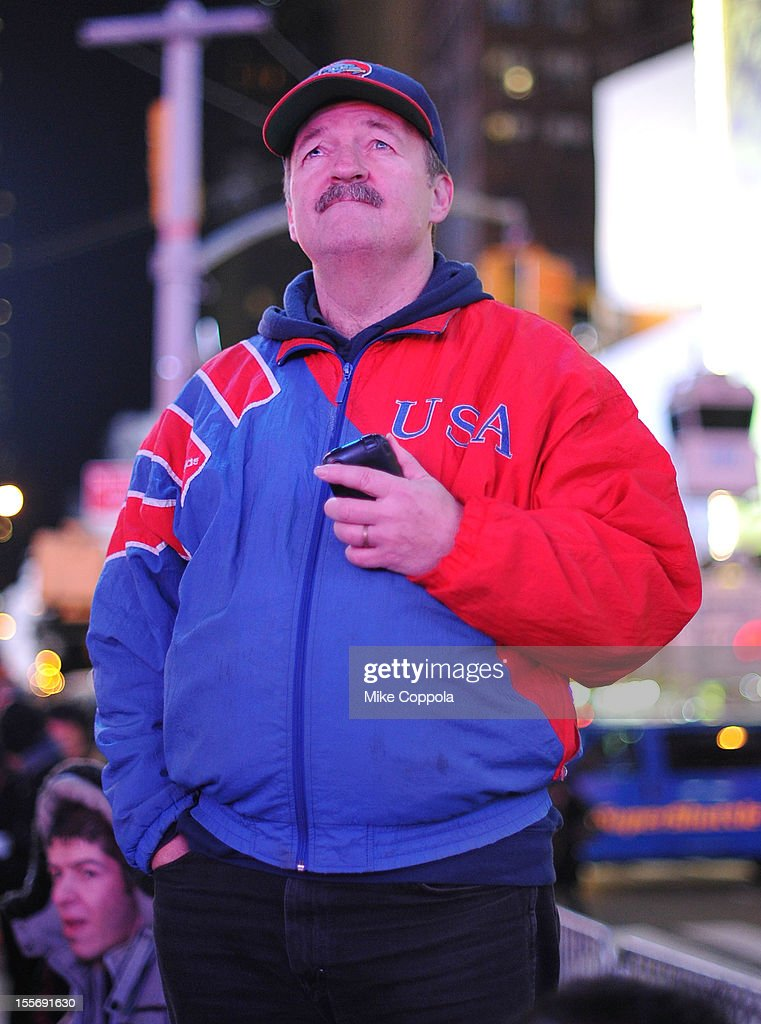 A spectator watches the results of the 2012 Presidential election night in Times Square on November 6, 2012 in New York City.