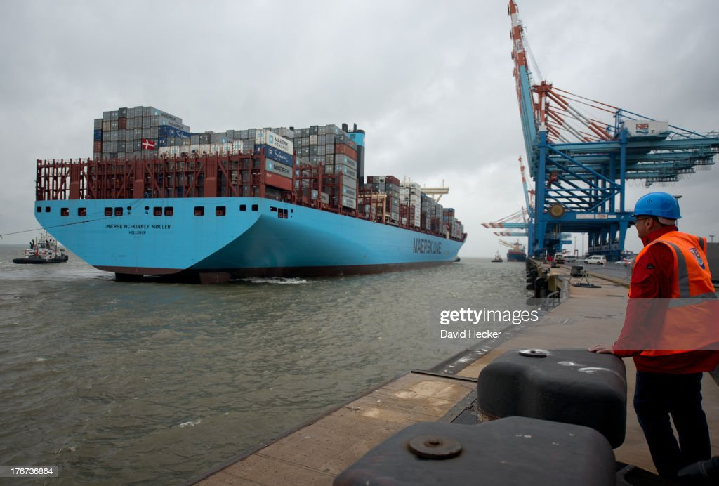 A spectator watches the world's biggest container ship, named the Maersk MC-Kinney Moller, arrives at the port of Bremerhaven, Germany on August 18, 2013. The ship has a length of 400 meters, it is 59 meters wide and is capable of delivering 18.000 TEU Container. The ship carries the first Triple-E Standard (Economy of Scale, Energy Efficiency, Environmentally-improved) and is the most efficient and energy saving container ship in the world.