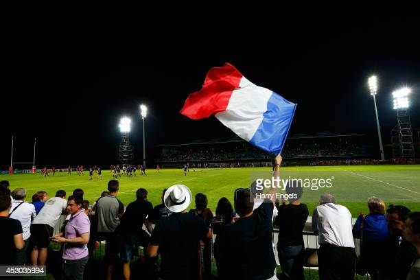 A spectator waves a French flag during the IRB Women's Rugby World Cup Pool C match between France and Wales at the French Rugby Federation...