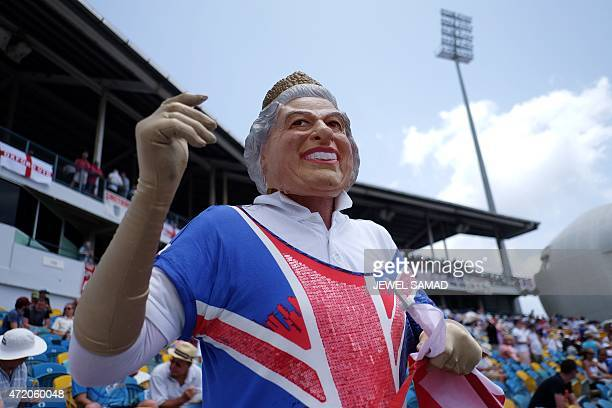 A spectator wearing a mask of Britain's Queen Elizabeth II waves during day three of the final match of a threematch Test series between England and...