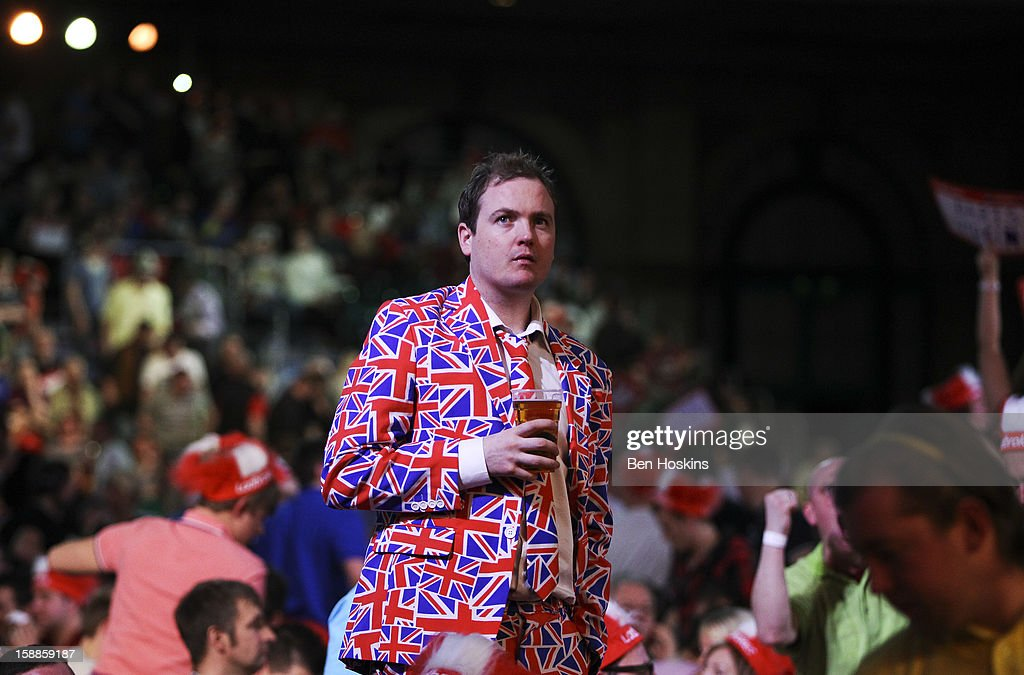 A spectator, wearing a suit with Union flag design, looks on during the final of the 2013 Ladbrokes.com World Darts Championship at the Alexandra Palace on January 1, 2013 in London, England.