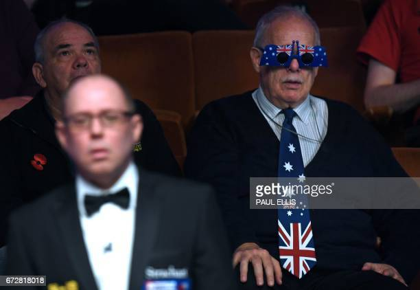 A spectator wearing an Australian novelty tie and spectacles watches the quarter final between Scotland's Stephen Maguire and England's Barry Hawkins...