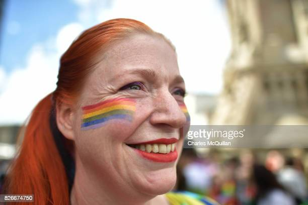 A spectator wearing face paint watches on as Belfast Gay Pride takes place on August 5 2017 in Belfast Northern Ireland The province is the only part...