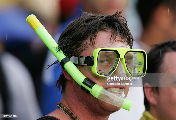 A spectator wears a mask and snorkel during a rain delay in the Commonwealth Bank One Day International Series second final match between Australia...