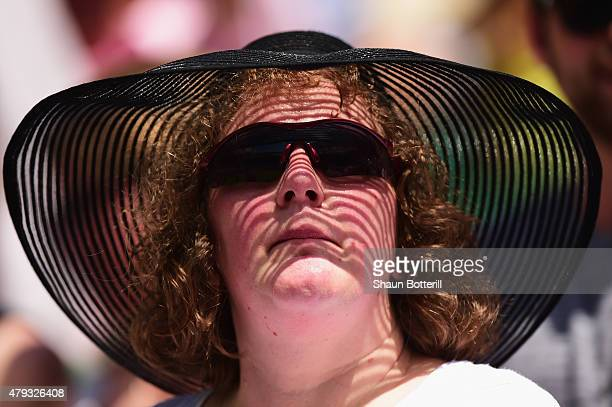 A spectator wears a sun hat as she watches the Gentlemen's Singles Third Round match between Grigor Dimitrov of Bulgaria and Richard Gasquet of...