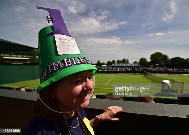 A spectator with a bucket and bucket list on her head is seen on day one of the 2015 Wimbledon Championships at The All England Tennis Club in...