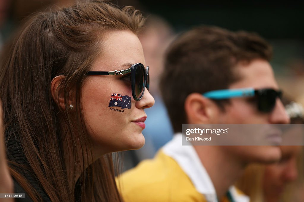 A spectator with the Australian national flag painted on her face watches the action during day one of the Wimbledon Lawn Tennis Championships at the All England Lawn Tennis and Croquet Club on June 24, 2013 in London, England.