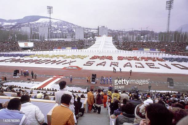 Spectators and athletes from all over the world watch the opening ceremony of the XIVth Winter Olympic Games 07 February 1984 in Sarajevo AFP...