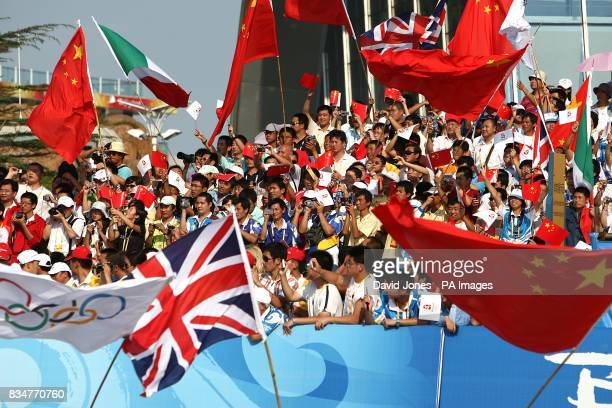 Spectators and fans show their colours and support at the Olympic Games' Sailing Centre in Qingdao on day 12 of the 2008 Olympic Games in Beijing